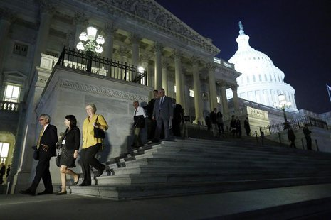 Members of the U.S. House of Representatives depart after a late-night vote on fiscal legislation to end the government shutdown, at the U.S