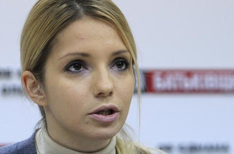 Yevgenia Tymoshenko, the daughter of jailed opposition leader and former Ukrainian Prime Minister Yulia Tymoshenko, makes a statement during