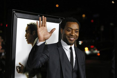 "Cast member Chiwetel Ejiofor waves at a special screening of ""12 Years a Slave"" at the Directors Guild of America in Los Angeles, California"