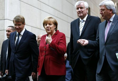 German Chancellor and leader of the Christian Democratic Union (CDU) Angela Merkel and party members arrive for preliminary coalition talks