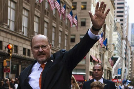Republican New York City mayoral candidate Joe Lhota waves to people as he attends the 69th Annual Columbus Day Parade in New York, October