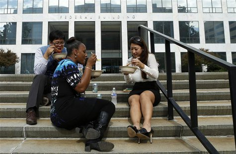 Workers have lunch on the steps of a federal in Washington October 17, 2013. REUTERS/Kevin Lamarque