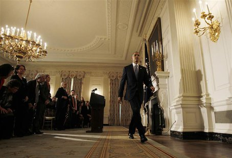 U.S. President Barack Obama departs the White House State Dining Room after delivering remarks on the end of the U.S. government shutdown in