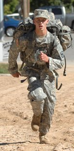 Spc. Dalton DeBoer competes in the 6-mile road march during the annual South Dakota Army National Guard Best Warrior Competition at Camp Rapid in Rapid City, S.D. DeBoer is a sophomore at SDSU. (Photo courtesy of the S.D. Army National Guard)