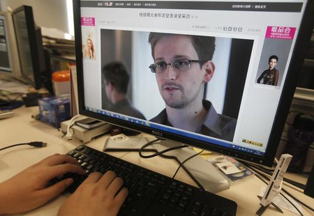 A picture of Edward Snowden, a contractor at the National Security Agency (NSA), is seen on a computer screen displaying a page of a Chinese