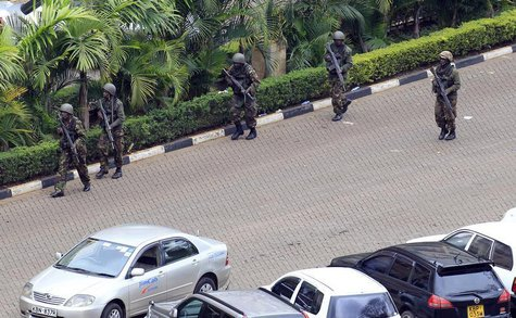 Kenya Defence Forces soldiers take their position at the Westgate shopping centre, on the fourth day since militants stormed into the mall,
