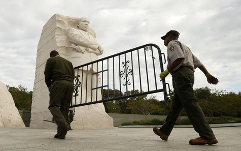 National Park workers remove a barricade at the Martin Luther King Jr. Memorial as it reopens to the public in Washington October 17, 2013.