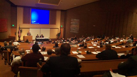 The unusual joint meeting was held in the big auditorium at the Fetzer Center.
