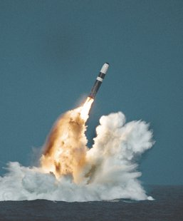 A Sea Launched Trident Missile breaks surface during a test.  (Navy.mil image)