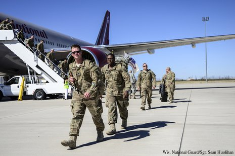 Members of the Wisconsin Army National Guard's Battery B, 1st Battalion, 121st Field Artillery arrive at Fort Bliss, Texas Oct. 11 following a combat deployment to Afghanistan. (Photo by: WI National Guard/Sgt. Sean Huolihan).