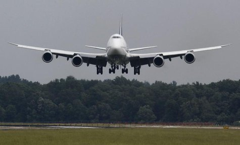 A Lufthansa Boeing 747-8 touches down at Dulles International Airport outside Washington for the first time June 1, 2012. REUTERS/Larry Down