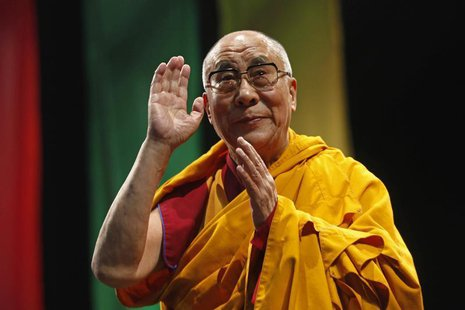 "The Dalai Lama greets the audience before his conference ""A guide to the way of life of Bodhisattva"" in Mexico City, October 12, 2013. REUTE"