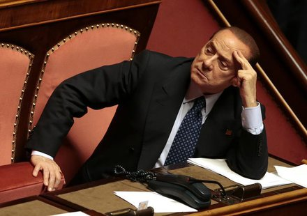 Italian center-right leader Silvio Berlusconi (R) looks on at the Senate in Rome, October 2, 2013. REUTERS/Tony Gentile