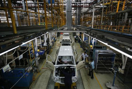 Employees work on the Chevrolet Tavera compact MPV assembly line inside a plant of General Motors India Ltd. at Halol, east of the western I