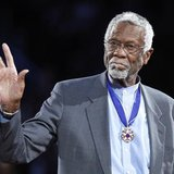 Boston Celtics' legend Bill Russell stands with his Presidential Medal of Freedom during the NBA All-Star basketball game in Los Angeles, in