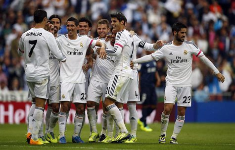 Real Madrid's Angel Di Maria (4th L) celebrates with teammates after scoring a goal during their Spanish first division soccer match against
