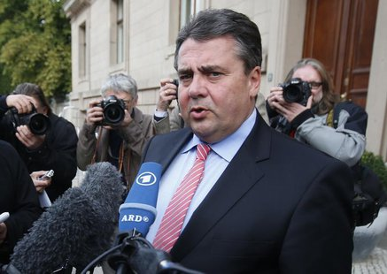 Social Democratic Party (SPD) party leader Sigmar Gabriel addresses the media after preliminary coalition talks between Germany's conservati