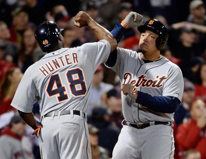 Oct 19, 2013; Boston, MA, USA; Detroit Tigers players Torii Hunter (left) and Prince Fielder celebrate after both scoring runs against the B