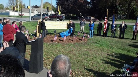 A sign for the Sgt. Benjamin Edinger Corridor of the west side trail is unveiled on Oct. 19, 2013. (Photo by: FOX 11).