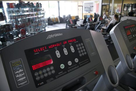 The controls for a treadmill at the Bally Total Fitness facility in Arvada, Colorado June 15, 2009. REUTERS/Rick Wilking