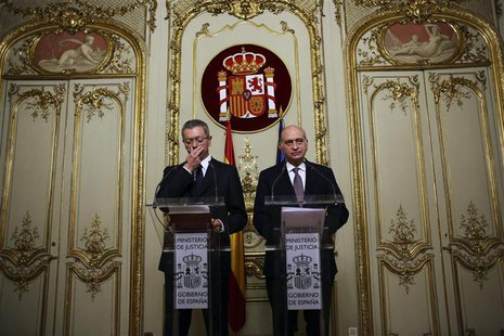 Spain's Justice Minister Alberto Ruiz-Gallardon (L) and Spain's Interior Minister Jorge Fernandez Diaz hold a joint news conference in Madri