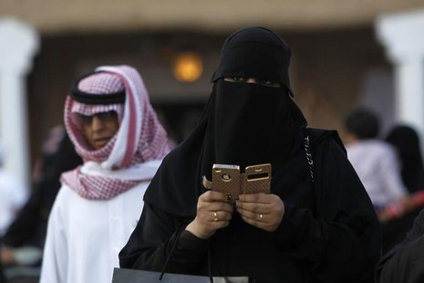 A woman using an iPhone visits the 27th Janadriya festival on the outskirts of Riyadh in this February 13, 2012 file photo. REUTERS/Fahad Sh