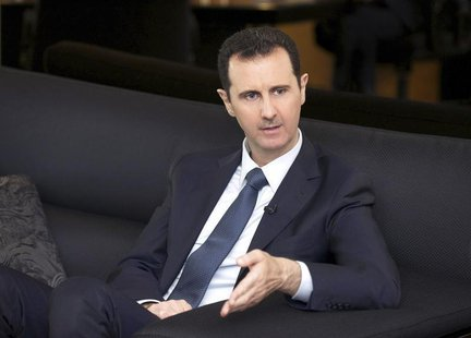 Syria's President Bashar al-Assad speaks during an interview with German magazine Der Spiegel in Damascus, in this handout photograph distri