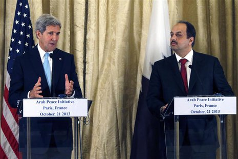 U.S. Secretary of State John Kerry (L) and Qatar's Foreign Minister Khalid bin Mohamed al-Attiyah (R) attend a news conference at the U.S. A