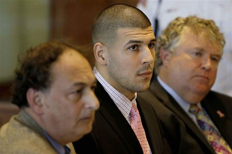 Former New England Patriots NFL football playerAaron Hernandez, (C), sits with his attorneys James Sultan (L) and Michael Fee in Bristol Sup