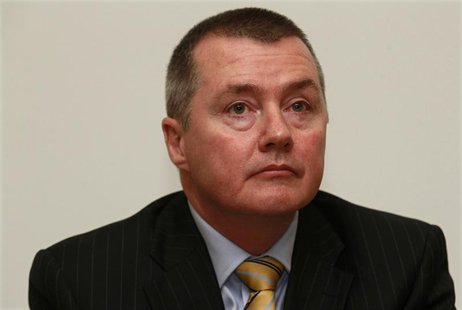 Chief Executive Willie Walsh of IAG attends a news conference in London November 17, 2011. REUTERS/Suzanne Plunkett