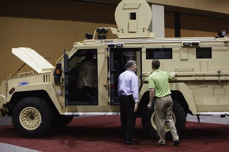 Attendees look at the Lenco MRAP Bear SWAT Team vehicle at the 7th annual Border Security Expo in Phoenix, Arizona March 12, 2013. REUTERS/J