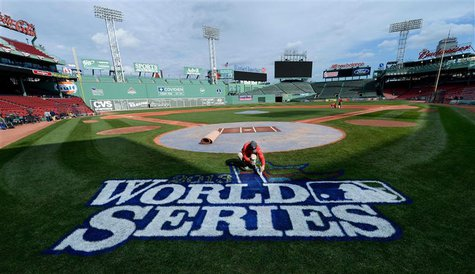 Oct 22, 2013; Boston, MA, USA; Chris Williams paints the World Series logo on the field during media day the day before game one of the 2013