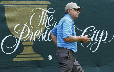 International Team captain Nick Price of Zimbabwe carries a two-way radio during the second practice round for the 2013 Presidents Cup golf