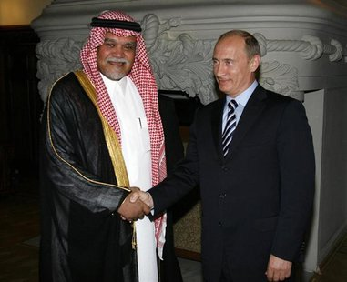 Prince Bandar bin Sultan (L), Secretary-General of Saudi Arabia's National Security Council, shakes hands with Russia's Prime Minister Vladi