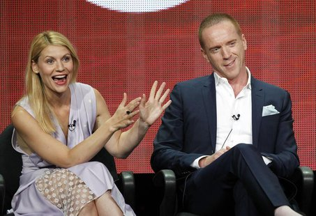 "Cast member Claire Danes gestures next to co-star Damian Lewis at a panel for the television series ""Homeland"" during the Showtime portion o"