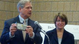 Senator's John Hoeven and Amy Klobuchar with an Event Data Recorder