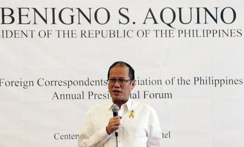 Philippines' President Benigno Aquino answer questions during a Foreign Correspodents Association of the Philippines (FOCAP) forum at a hote