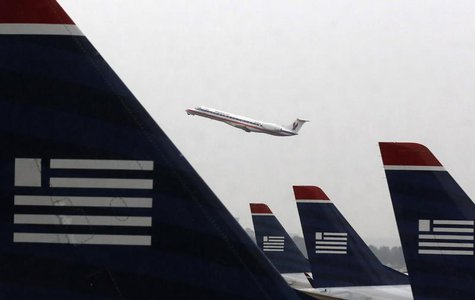 U.S. Airways jets are lined up at Reagan National Airport in Washington July 12, 2013. REUTERS/Larry Downing