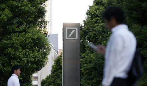 Men walk past a logo of Deutsche Bank AG in Tokyo September 9, 2013. REUTERS/Toru Hanai