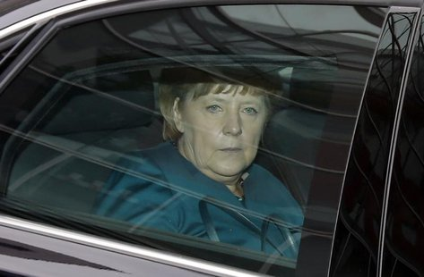 German Chancellor and leader of the Christian Democratic Union (CDU) Angela Merkel sits in her limousine as she leaves the first round of co