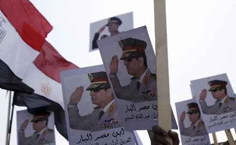 Posters of Army Chief General Abdel Fattah al-Sisi are seen as supporters of the army protest against ousted Islamist President Mohamed Murs
