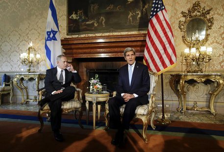 U.S. Secretary of State John Kerry (R) poses with Israeli Prime Minister Benjamin Netanyahu at Villa Taverna in Rome October 23, 2013. REUTE