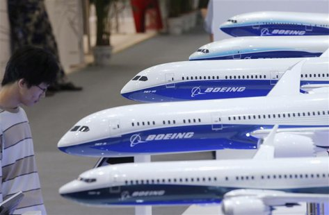 A visitor looks at a display of miniature Boeing passenger aircrafts at Aviation Expo China 2013 in Beijing in this September 25, 2013 file