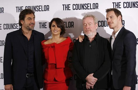 (L-R) Actors Javier Bardem and Penelope Cruz, Director Ridley Scott and actor Michael Fassbender pose for photographers at a photocall for t