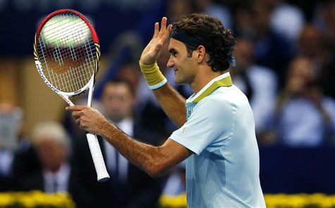 Switzerland's Roger Federer reacts after winning his match against Adrian Mannarino of France at the Swiss Indoors ATP tennis tournament in