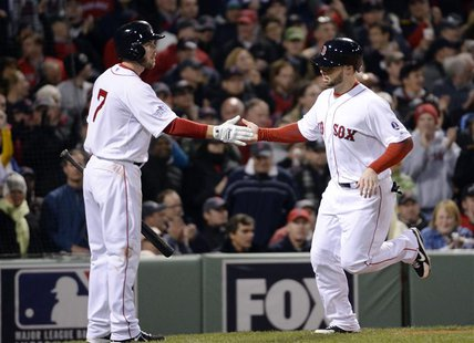 Oct 23, 2013; Boston, MA, USA; Boston Red Sox pinch hitter Daniel Nava (right) is congratulated by shortstop Stephen Drew (not pictured) aft