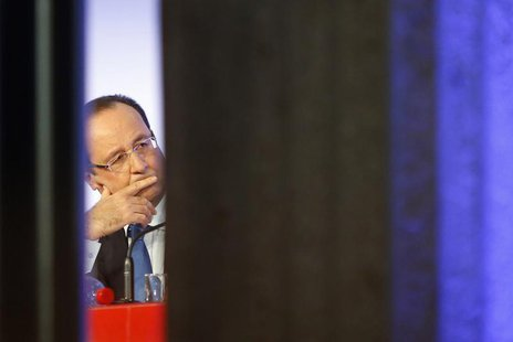 "France's President Francois Hollande listens to a speech during a meeting called ""Reporters of Hopes, Solutions for France"" at Iena Palace i"