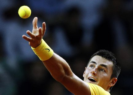 Australia's Bernard Tomic serves the ball to Poland's Lukasz Kubot during their Davis Cup play-off tennis match in Warsaw September 15, 2013
