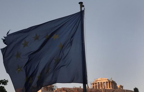 An European Union flag flutters in front of the Parthenon temple in Athens August 20, 2013. REUTERS/John Kolesidis
