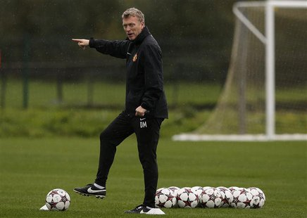 Manchester United's manager David Moyes gestures during a training session at the club's Carrington training complex in Manchester, northern